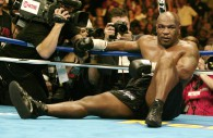 Mike Tyson sits on the canvas after being knocked out by Danny Williams.